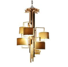 Bring a boost of brightness to any room of the house with this brass chandelier. This elegant piece features multiple branches, alternating satin and. Lighting Collections, Glass Chandelier, Cool Lighting, Modern Chandelier, Buy Chandelier, Geometric Chandelier, Modern Lamp, Contemporary Brass Chandelier, Chandelier