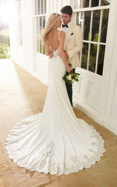 This designer sheath wedding dress from Martina Liana boasts graphic lace appliques with pearl and Diamante embellishments and illusion-lace sides and back. The Bellagio crepe skirt features gorgeous lace detailing and beading on its chapel train.