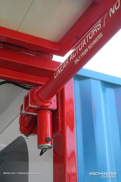 Linear actuators made just for Schweiss Doors went on this beautiful container