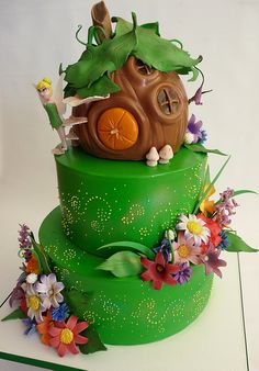 Tinkerbell cake - Tinkers house buttercream bottom two tiers, fondant covered third tier. gumpaste hand painted flowers and accessories