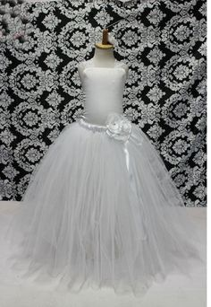 A simply breathtaking for little girls! White for an angel baby with ivory diamond look. Fabric: Soft Tulle for the and satin top with lace ribbons to tie at the back. Girls Party Wear, Girls Wear, Girls Tutu Dresses, Flower Girl Dresses, Satin Top, Lace Ribbon, White Flowers, Dresses Online, Little Girls