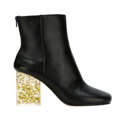 """Nicole Phelps, Director, Vogue Runway - """"After an embarrassing (and painful!) fall in clogs on the Second Avenue F train platform a few weeks ago, I've resolved to wear only sensible shoes during New York Fashion Week. Do these Maison Margiela booties count? Maybe yes, maybe no, but I can't stop thinking about them."""" Maison Margiela glitter heel boots, $1,395, Buy it now"""