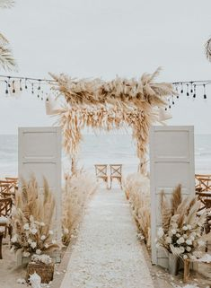 This beach ceremony set up is straight out of a dream! | Image by Hipster Wedding