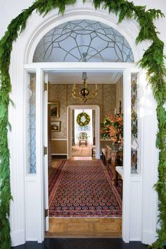 This Entryway has such handsome features The door with a palladium transom,arched frame & sidelights is a classic.One can see how large & formal the Foyer is from outside.