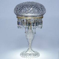 "Lot:622: Cut glass lamp, Hobstars, honeycomb, 21"", Lot Number:622, Starting Bid:$750, Auctioneer:Humler & Nolan, Auction:622: Cut glass lamp, Hobstars, honeycomb, 21"", Date:03:00 AM PT - Nov 3rd, 2007"