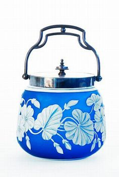 A Thomas Webb & Sons style two colour cameo ice bucket, of squat cylindrical form, the blue glass overlaid with trailing nasturtiums
