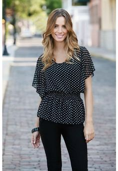 Dotted chiffon flutter sleeve blouse. A subtle v-neck top in a black and white polka dot print features short flutter sleeves and comfy, smocked waist. Semi-sheer fabric works best layered over your favorite cami. Domestic poly. Sizes S, M, L. Black/white (BK). 5472  $14.90.