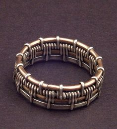 Ring | Mary Tucker.  Bronze and Sterling woven.