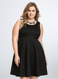 Ready for a night out on the town, this black skater style has a fitted bodice that will define your top, and a fit and flare skirt that will be so amazing to dance in. Best part of all? The scuba fabric gets some added sheen with a subtle leopard spot print.