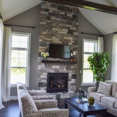 The Dakota includes all the amenities for today's modern family. Stone Fireplace Wall, Stone Fireplace Designs, Gas Fireplace, Fireplaces, Side Window, Modern Family, Model Homes, Great Rooms, Heavenly