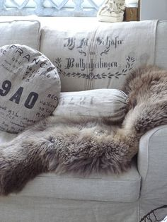 Sheepskin/Fur on the sofa! Cozy & great for helping keep the seat cushions cleaner when the kids and dog are rolling around on the couch.