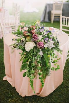 Rustic floral covered sweetheart table: http://www.stylemepretty.com/little-black-book-blog/2016/05/25/sweet-diy-details-rustic-barn-wedding/ | Photography: Alexandra Meseke - http://alexandrameseke.com/