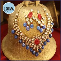 A beautiful Kundan Ethnic Indian Bridal Necklace Set from SIA STAR SIGNATURE LINE. The necklace is embellished with lovely crafted Vilandi Kundans and the ocean blue pearls at the bottom provides it the rich royal look . Kundan jewellery is the oldest form of jewellery made and worn in India.