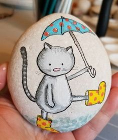Cat with umbrella painted Rock