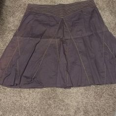 Knee length brown and gold skirt Brown(with a pinkish hue) skirt with gold metallic thread trim. Knee length, or slightly below. Old Navy Skirts A-Line or Full