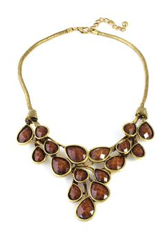 Earthy toned decorates gorgeously faceted teardrop stones to give this necklace a glamorous look.Item Details:- Lobster Clasp- Acrylic, Plated Base Metal- Length: 18