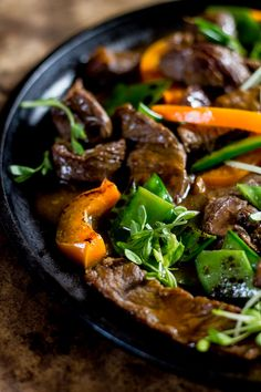 Flavorful beef stir-fry with peppers + pea shoots. A quick and delicious meal, ready in minutes. Asian Recipes, Beef Recipes, Healthy Recipes, Ethnic Recipes, Pepper Recipes, Pea Shoot Recipe, Marinated Flank Steak, My Burger, Gourmet