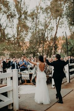 We love the back of this stunning wedding dress by Pronovias | Image by Emily Magers Photography #receptiondecor #bridalfashion #weddingdress #bride #groom #weddingdecor #rusticwedding #backyardwedding #californiawedding