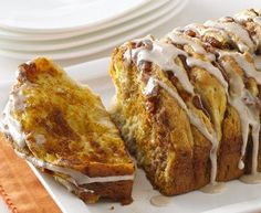 Pumpkin Spice Pull Apart Bread - 1   can (16.3 oz) Pillsbury® Grands!® Flaky Layers refrigerated honey butter biscuits (8 biscuits)    3/4   cup pumpkin pie filling    2   tablespoons butter, melted    1/3   cup sugar    1   teaspoon pumpkin pie spice    2   cups powdered sugar    1/4   cup milk    1   teaspoon vanilla    1/2   teaspoon pumpkin pie spice