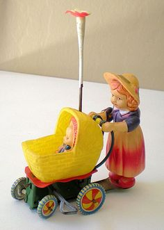 Circa 1920's-30's Old Celluloid Wind Up Toy Stroller With Baby Learn about your collectibles, antiques, valuables, and vintage items from licensed appraisers, auctioneers, and experts http://www.bluevaultsecure.com/roadshow-events.php