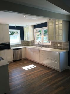 Another view of the kitchen off white ikea bodbyn glass for Navy blue granite countertops