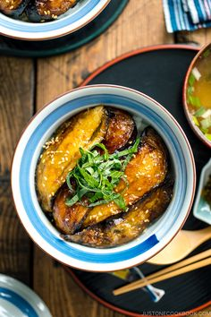 With thinly sliced eggplant seared till golden brown and coated with sweet soy sauce this Soy-Glazed Eggplant Donburi is an incredibly delicious Japanese vegan rice bowl dish Just 30 minutes start to finish Easy Japanese Recipes at JustOneCookbook Japanese Vegetarian Recipes, Easy Japanese Recipes, Asian Recipes, Ethnic Recipes, Japanese Rice Bowl, Japanese Food, Rice Bowls, Vegan Dishes, Other Recipes