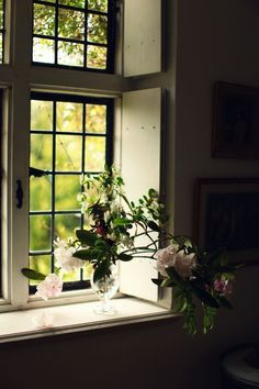 Deep window with vase of flowers on the sill via Ana Rosa.