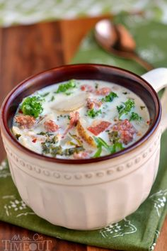 Get ready to please the whole family with this copycat Slow Cooker Olive Garden's Zuppa Toscana Soup! Comfort food at it's best! | MomOnTimeout.com | #recipe #soup #copycat #dinner