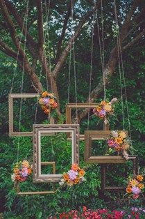 Bohemian inspired frames as a ceremony backdrop for picture-taking for guests. Get them printed for and sent for thank-you's