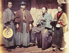 Three samurai being served tea.