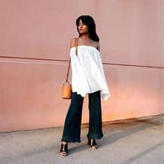 31 Perfect Outfits To Copy This May #refinery29  http://www.refinery29.com/2016/05/109647/new-outfit-ideas-may-2016#slide-18  When all else fails, an off-the-shoulder top + wide-legged jeans + simple mules = a no-brainer outfit equation.Finders Keepers top, Style Mafia pants, Simon Miller bag....
