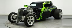 This 1934 Ford Hot Rod was sold for 100,000 USD, it features a custom chopped fiberglass body with suicide doors, custom black leather interior stitched in exterior matching lime-green and custom built frame that sits a supercharged GM's 350 cubic small block V8 (ZZ350) engine. It develops around 600 HP and is mated to a Turbo-hydramatic 350 3-speed transmission.