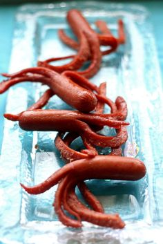 Octopus / Squid use organic Hot Dogs, boil in water to get curled tentacles