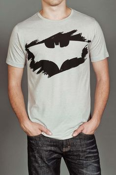 Kinetix Batman Stencil Tee- this would be so easy to copy. Find batman symbol. Print and cut out. Trace onto cereal box cardboard. Tape to shirt. Paint over it with black fabric paint. Voila!