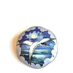 Gustav Gaudernack design for own workshop. Enamel on guilloché silver brooch. Seagull with painted naturalistic sea. 1910-14