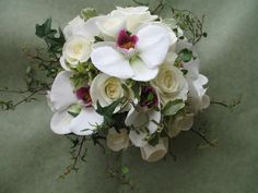 posy of white roses and phalanopsis orchids