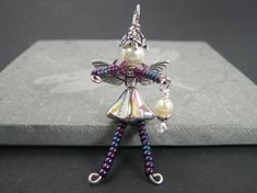 ELYSSA Flower Fairy Ornament - Beaded Fairy - Fairy Charm - Wine Bottle Decoration - Pink Faery - Purple Faerie - Zipper Pull - Phone Charm. $8.50, via Etsy.