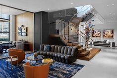 Best At The Office Posts of 2020 Executive Suites, Downtown New York, Z New, Curved Sofa, Jay Z, Concrete Floors, Magazine Design, Leather Sofa, White Walls