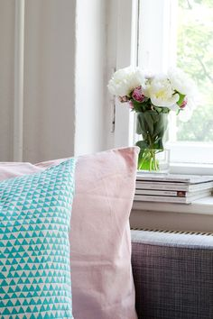 Spring Additions: Flowers and Pillows   Not Your Standard