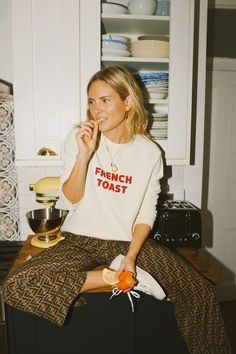 Loungewear outfit ideas: Lucy Williams in logo trousers and sweater