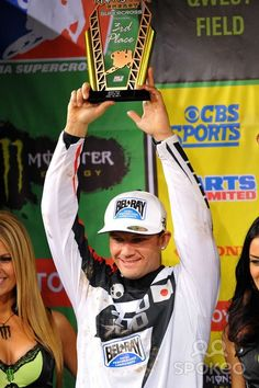 Chad Reed (22) holds up his 3rd place trophy during the Seattle supercross at Quest Field.