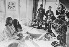 "1969: Beatles singer, songwriter and guitarist John Lennon and his wife of a week Yoko Ono receive the press at their bedside in the Presidential Suite of the Hilton Hotel, Amsterdam. The couple stayed in bed for seven days ""as a protest against war and violence in the world."""