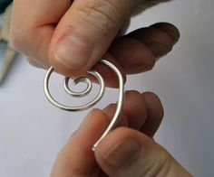 This hand-shaped, hammered spiral keeps your scarf or shawl in place without piercing or snagging the yarns