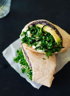A simple burrito filled with beans and greens that is packed with flavor!