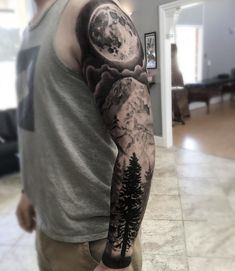 Black and grey realism moon night sky mountain forest trees sleeve tattoo, by Aaron Carey