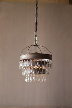 A strong piece of decor for any home, this ceiling pendant lamp features layered shade with gems detail.Color: GreyMaterial: MetalDimensions: 10d x 13H
