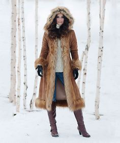 Donna Salyers Fabulous-Furs Tobacco Hooded Faux Suede Coat Styled with faux suede and fur, this jacket boasts lavish style and warmth. It's oversize hood and full-coverage length make it ideal against the cold.
