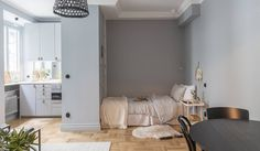 tiny grey/blue studio apartment