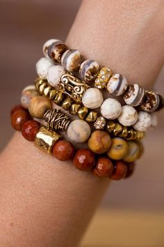Add a touch of nature to any outfit with this unique stack of beaded bracelet designed and handmade in the South featuring semi-precious gemstones and gold accent beads.
