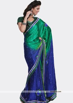 Shine with simplicity with this green and blue shade saree, adorned with silver dots. Floral embroidered patch work is enhancing its beauty. It will look good for semi-formal parties. http://goodbells.com/saree/shiny-green-and-blue-shade-saree.html